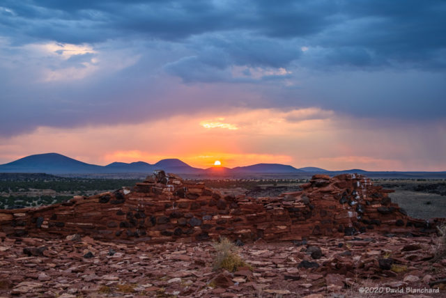 The sun sets over ruins in Wupatki National Monument.
