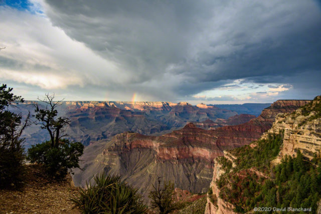 Rainbow segment over the North Rim of Grand Canyon.