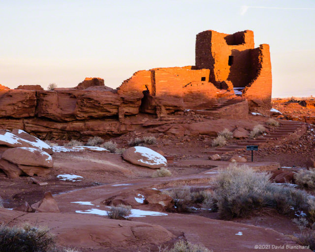 Sunlight strikes the top of Wukoki Pueblo a few minutes after sunrise.