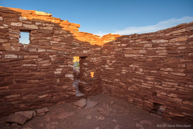 Moon rise over the interior of Lomaki Pueblo.