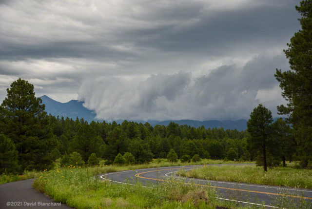 Low clouds from thunderstorms envelop the San Francisco Peaks.
