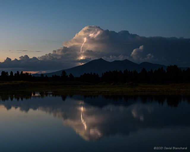 Lightning reflected in the ponds of the Kachina Wetlands.