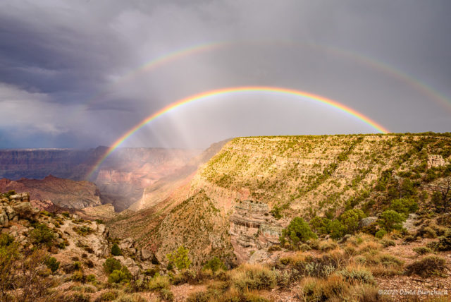 A double rainbow with supernumaries appears above Grand Canyon.