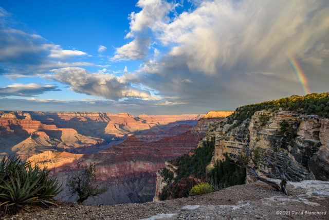 A rainbow segment appears just before sunset at Grand Canyon.