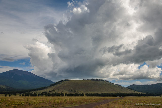 Thunderstorms begin to develop over the San Francisco Peaks.