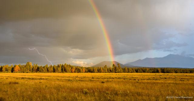 Distant lightning under the rainbow.