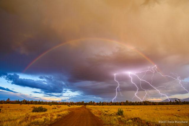 A multi-pronged lightning strike under the rainbow.