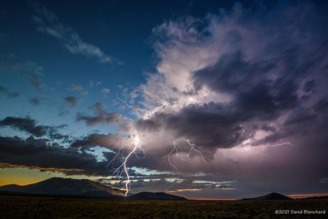 Twilight lightning over Kendrick Park. The north flanks of Kendrick Peak are illuminated by the bolt.
