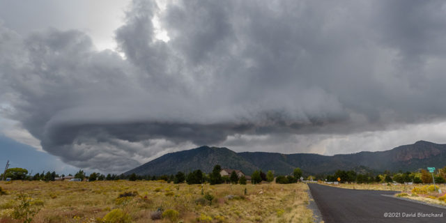 Shelf cloud associated with an outflow boundary from a cluster of thunderstorms moving over the San Francisco Peaks.